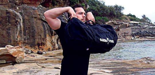 The Sandbag High Pull Exercise performed by Matt Palfrey.