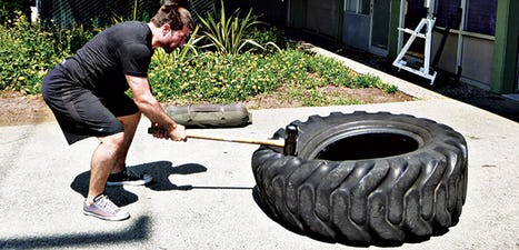 Tractor Tire Sledgehammer Slams are a must for unconventional training programs.