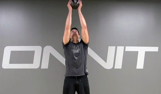 Mark de Grasse performs the Kettlebell 2-Hand Clean from Ground to Press