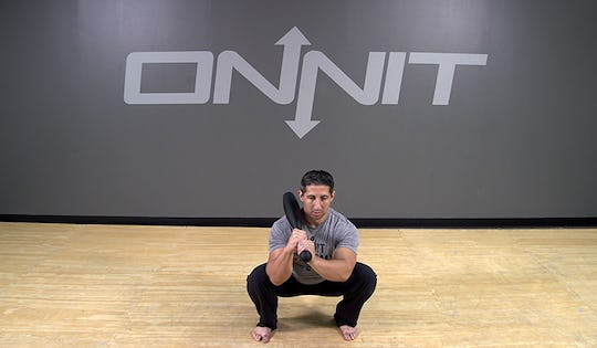 Steel Club Exercise: 2-Hand Shouldered Squat
