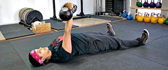 Press the kettlebell up over your chest and lock it out with a straight elbow.