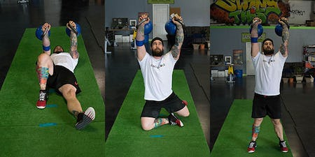 Joe Daniels performs the Double Heavy Kettlebell Turkish Get Up
