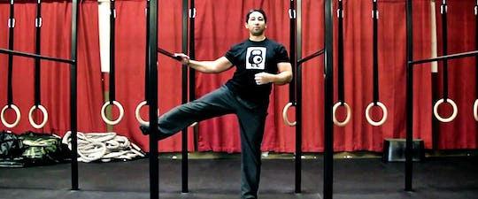 John Wolf performs the standing lateral lift to increase hip mobility,hip strength and alleviate back pain
