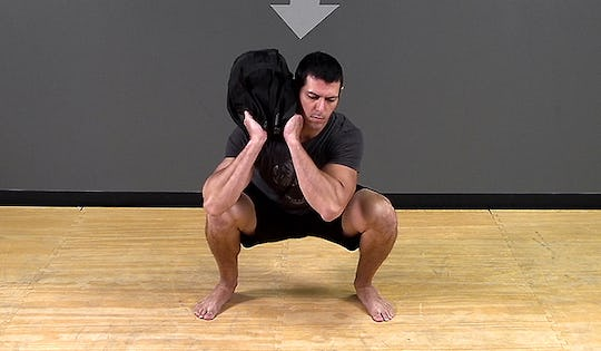 Sandbag Exercise: Shouldering Squat