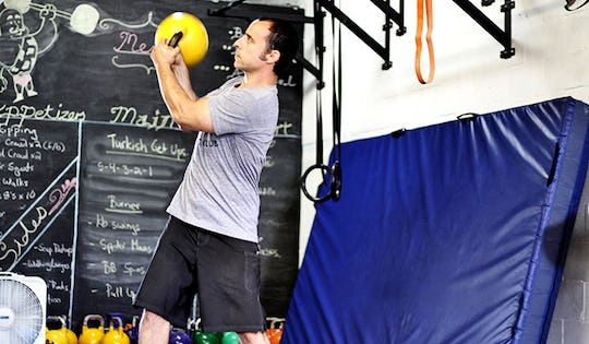 Shawn Mozen performs the kettlebell figure 8. A great movement for MMA Fighters
