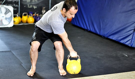 Shawn Mozen performs the kettlebell outside snatch. A great movement for MMA Fighters