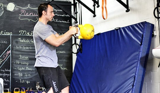 Shawn Mozen performs the kettlebell russian twist. A great movement for MMA Fighters