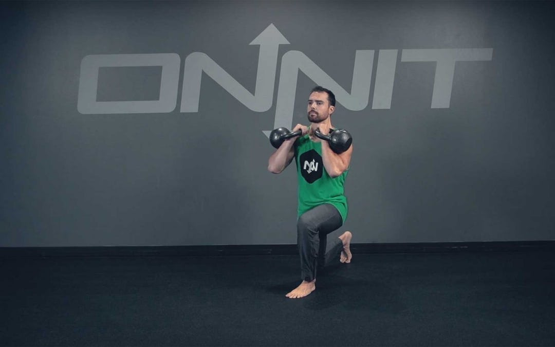 Double Kettlebell Reverse Lunge Exercise